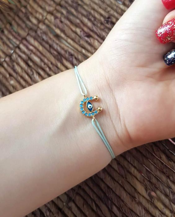 Bratara potcoava cu ochi protector, placata cu aur, decorata cu cristale Cubic Zirconia, culoare turcoaz, cu snur ajustabil [6]