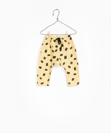 Pantaloni fleece galben cu negru0