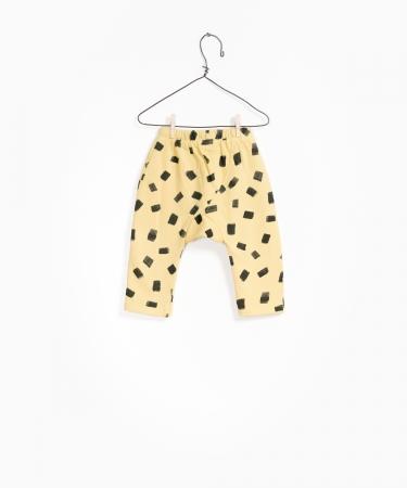 Pantaloni fleece galben cu negru1