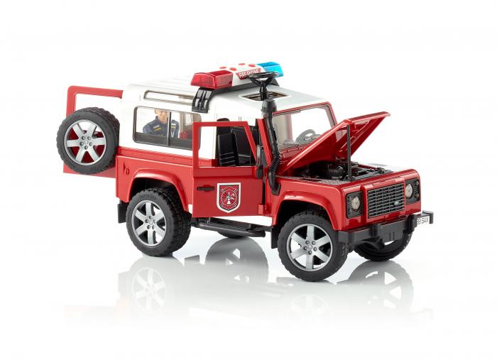 Masina de pompieri Land Rover Defender cu modul de lumini si sunet + figurina pompier cu accesorii, Bruder 1