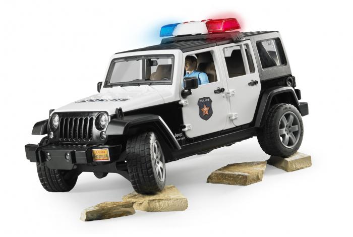 Masina de politie Bruder tip Jeep Wrangler Rubicon cu modul lumini + sunet si figurina politist, Bruder 0