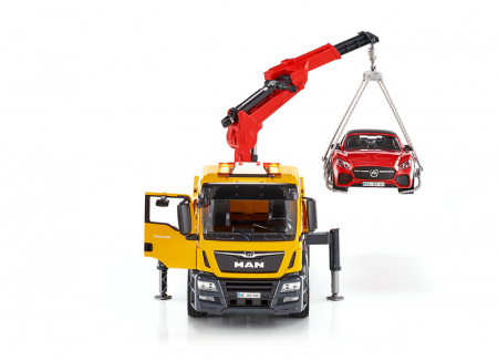 Jucarie camion platforma de tractare Man TGA cu modul de lumini si sunet+ masina Roadster Bruder1