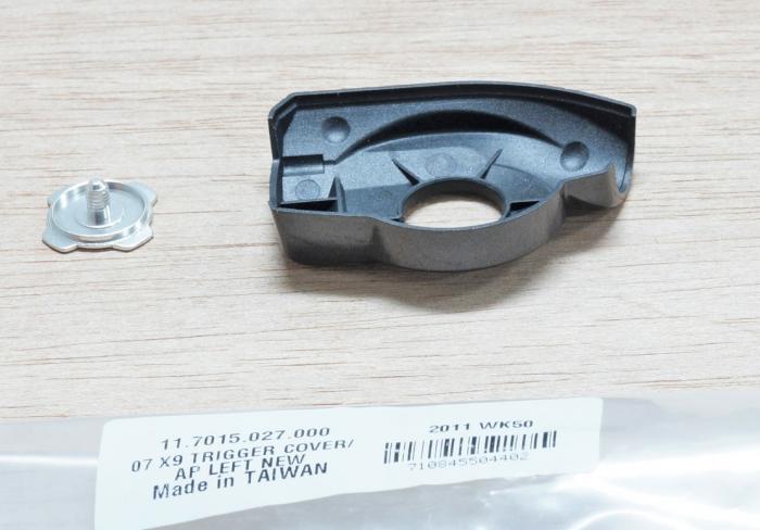 07-09 X9 Trigger Cover/Cap, Left New (< Nov 06) 1