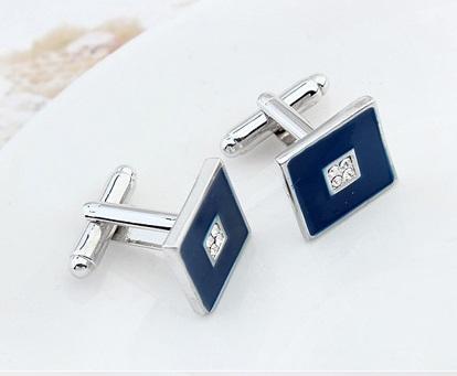 Butoni dark blue cu cristale, placati cu aur, garantie 6 luni [0]