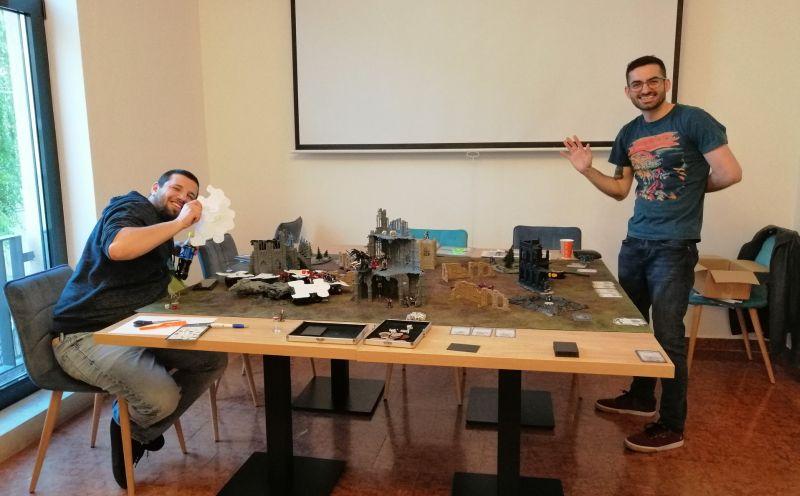 Two guys playing Warhammer 40k
