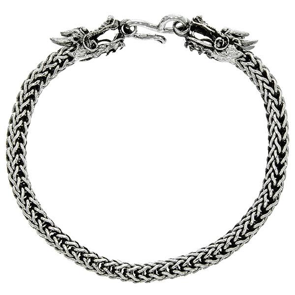Brățară din argint masiv deosebită, împletită, cu capete de dragoni [1]