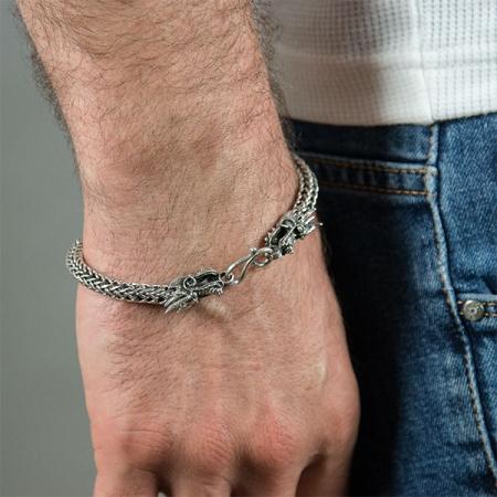 Brățară din argint masiv deosebită, împletită, cu capete de dragoni [2]