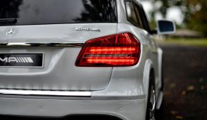 Masinuta electrica Mercedes GLS63 AMG 4x4 PREMIUM 24V #Alb10