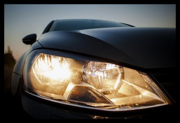 Tablou modern pe panou - beautiful black car headlights 0