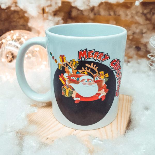 "Cana de craciun termosensibila realizata din ceramica – Design cu Mos Craciun si mesajul ""Merry Christmas"" 0"
