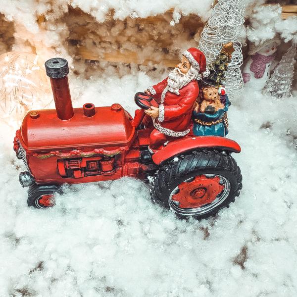 Decoratiune muzicala cu led pentru sarbatorile de iarna realizata din rasina – Mos Craciun cu cadouri in tractor 1