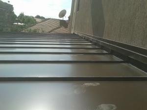Tabla plana din otel prevopsit DX51 sub forma de rulou cu latimea de 670mm, lungimea de 30m si grosimea de 0.55mm, RAL 8019 MAZZONETTO MAVIS 1