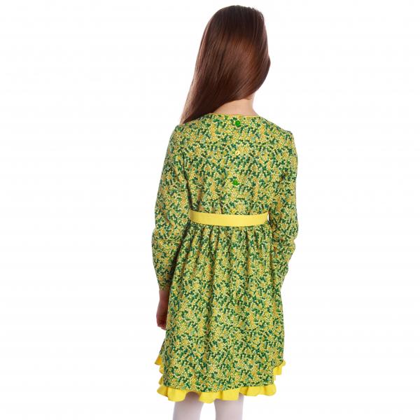 Rochiță veselă creată dintr-un material moale, foarte plăcut la purtat. Desenul reprezintă un puzzle de flori mici in diverse nuante de galben si verde.  Rochița are un volan galben la tiv și se leagă în talie cu un cordon în culoarea acestuia. Închiderea se face în spate, până în talie, cu nasturi mici, plați, pentru a nu crea disconfort. 2