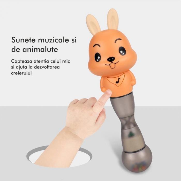 Jucarie muzicala electronica Maracas in forma de iepuras, cu zornaitoare, pentru copii si bebelusi, portocaliu 5