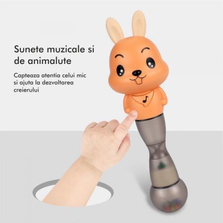 Jucarie muzicala electronica Maracas in forma de iepuras, cu zornaitoare, pentru copii si bebelusi, portocaliu5