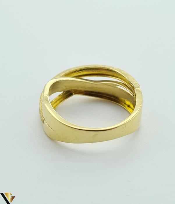 """Inel din aur 14k, 585 2.69 grame Latime inelului la partea superioara este de 6.8 mm Diametrul inelului este de 18mm Masura standard RO: 57 si UE: 18 Marcaj cu titlul """"585"""" Locatie Harlau [3]"""