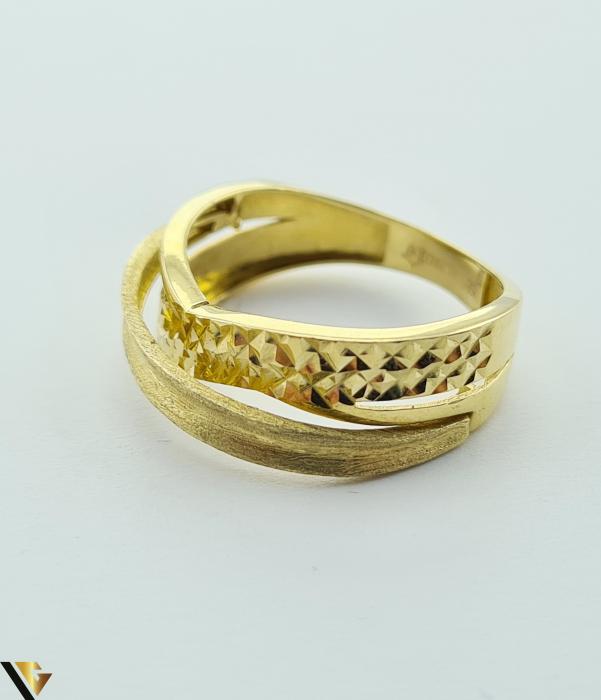 """Inel din aur 14k, 585 2.69 grame Latime inelului la partea superioara este de 6.8 mm Diametrul inelului este de 18mm Masura standard RO: 57 si UE: 18 Marcaj cu titlul """"585"""" Locatie Harlau [2]"""