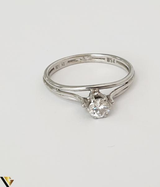 """Inel aur alb 18k,750 Diamant central """"Brilliant Cut"""" de cca. 0.30 ct,in montura suprainaltata Inaltimea inelului la partea superioara este de 5.90 mm Diametrul inelului este de 16.90 mm Locatie HARLAU 31692 1"""